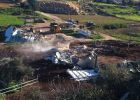 جرافات الاحتلال تهدم بركساً زراعياً وكرفاناً غرب بلدة إذنا بالخليل