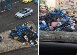 صور| رام الله: النفايات تملأ أرصفة دوار الساعة والبلدية توضح